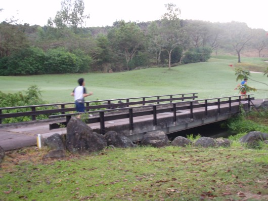 Crossing a bridge inside the golf course