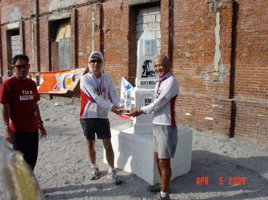 "With Race Organizer, Sir Jovie, aka ""The Baldrunner"" presenting Norio his trophy"