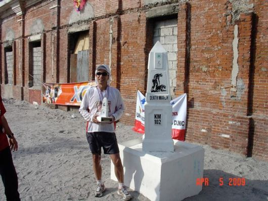 Norio making it to the finish in about 16 hours. Posing at the finish line (KM102) with trophy