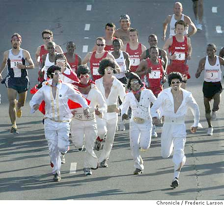 At the annual SF Bay to Breakers Race a group of Elvises crash the elite runners on the course at Howard near 4th Street but tired out quickly.   Benjamin Maiyo placed first overall in this year's annual Bay to Breakers race in San Francisco on Sunday. At the finish line at Ocean Beach says this is the 13th year in a row that a Kenyan runner has won the race. This is Maiyo's first win. Fellow Kenyan James Koskei had won the previous three years. Others not so serious about placing where thousands of party revelers from Elvises to naked George Bushes, Wonder Women and many beer wagons in tow.  Despite warnings from the organizers that police might issue citations for public nudity, the clothes still came off for many runners. Seventeen year-old Adam Bates was the first naked finisher overall.  5/16/04 San Francisco Chronicle Frederic Larson