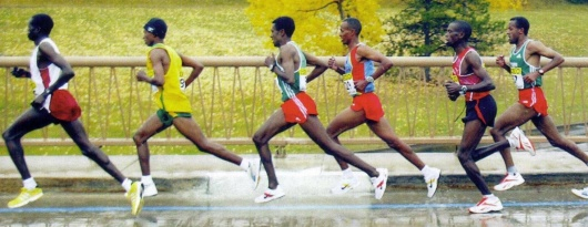 The Kenyan technique incorporates long, flowing, seemingly effortless stride.