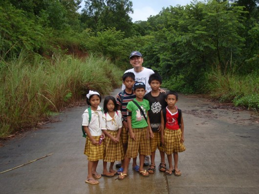June with school children who had to walk for 4kms to reach school. We would meet them again on our way back as their classes have been suspended due to the storm