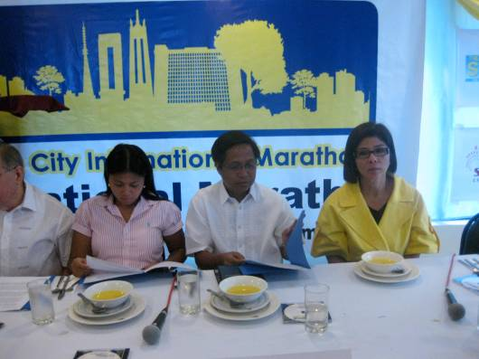 Mayor on left with Dr. Doray Delarmente, Rudy Fernandez (Runnex Pres) and Betty Rosario (Runnex Vice Chairman)