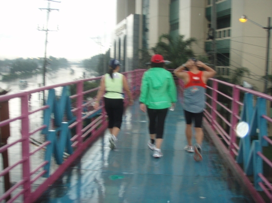 Towards the end of the footbridge then towards Batasang Pambansa