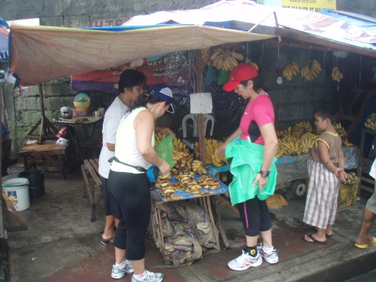 Its not goat meat they're buying but bananas--P10.00 isang tumpok of over-ripe bananas